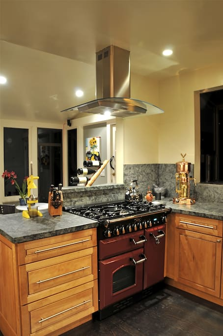 Chef's Kitchen with AGA duel fuel range and office in Breakfast Nook overlooking Garden.