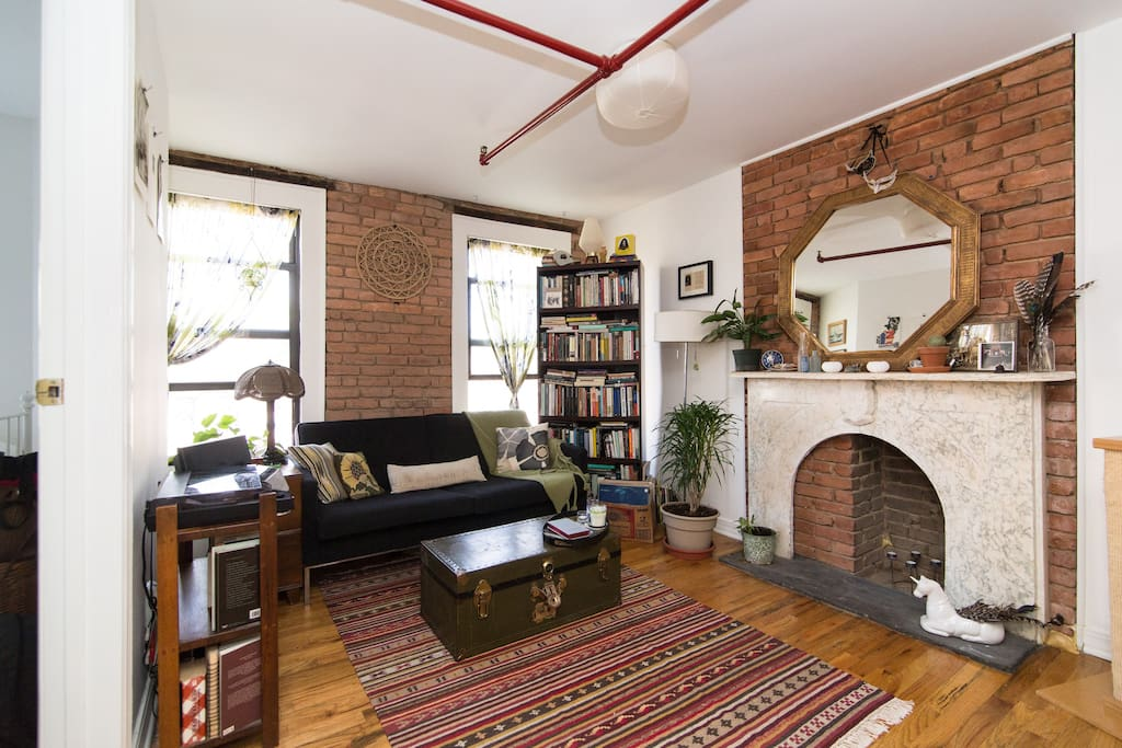 This is how the apartment was arranged when the Airbnb photographer took the photos. The couch is flipped and in the center of the room now.