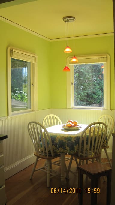 Bright breakfast nook in kitchen, overlooking back garden