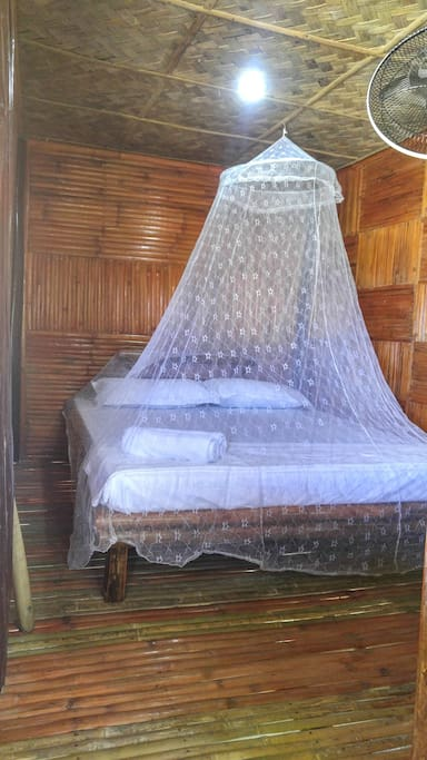 queen bed in family cabana