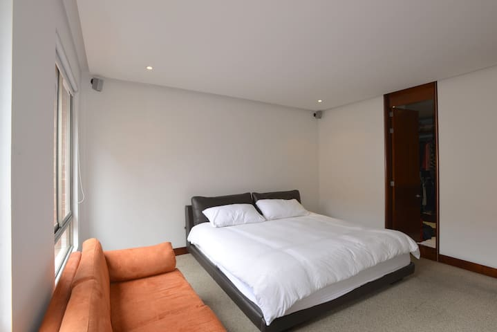Main room with 2x2 meters bed and private bathroom