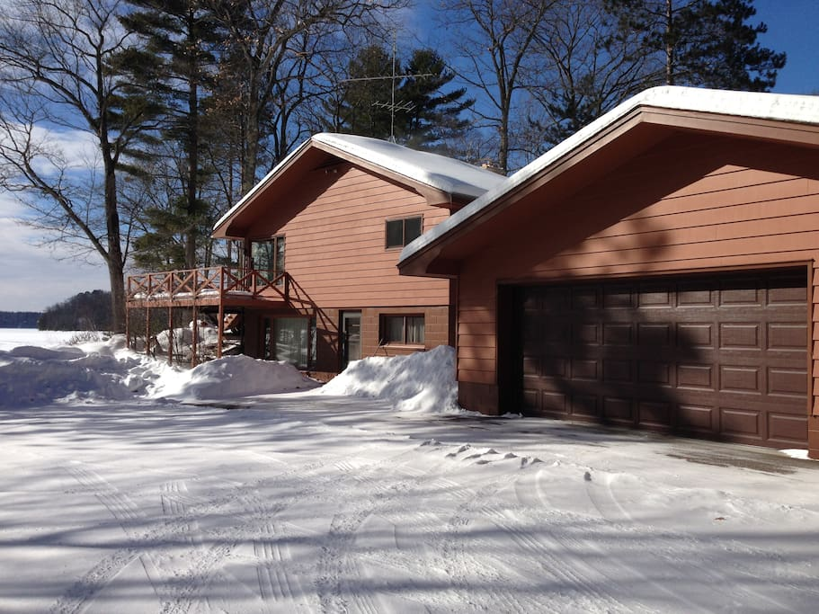 Lower level parking for snowmobiles or boat trailers. Situated with easy access to snowmobile trails.