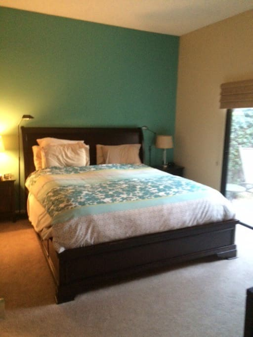 Master Bedroom with outside access to patio and pool