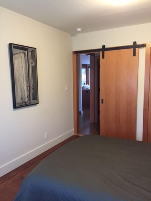 Bedroom entry barn door style door