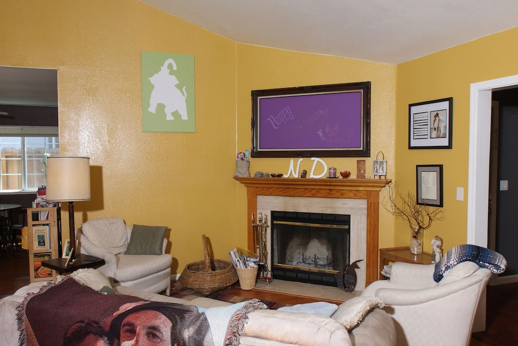 Cozy fireplace and create your own chalk art above the mantel.