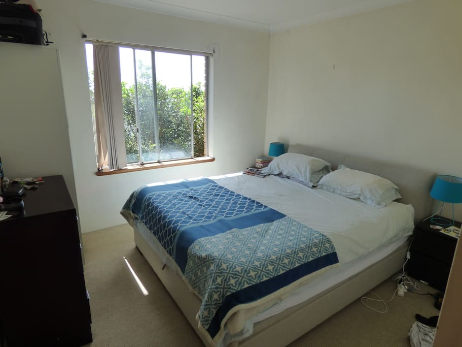 Main bedroom with king size bed. draws and hanging space available