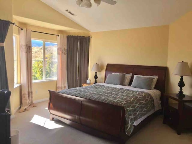 Large master bedroom with city view