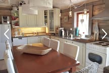 Kitchen with fridge, freezer, stove, dishwasher and extendeble dining table