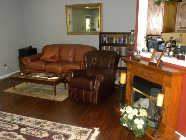 Living Room, front door opens to LR and to the left is a desk with house manual, guidebook and information you will need.