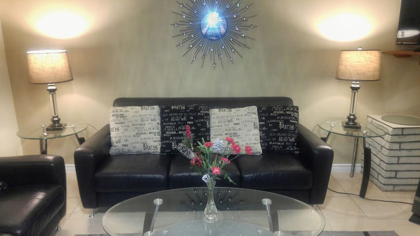 Leather comfortable modern living room suite with new crystal lamps.
