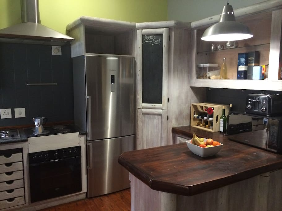 Fully Equipped Kitchen with Microwave and Gas Stove