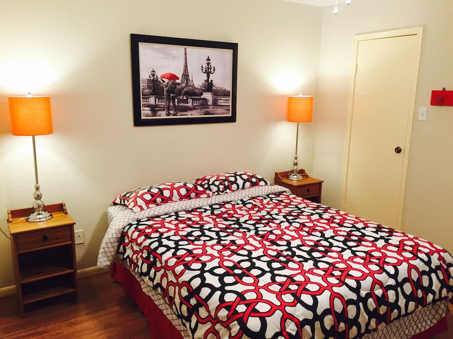 A queen size bed is in bedroom. Nine-leg frame ensures stability.