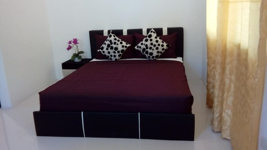 This room has 2 queen size beds that could fit in 4 person.There is also a couch in the bedroom for guest to seat on.