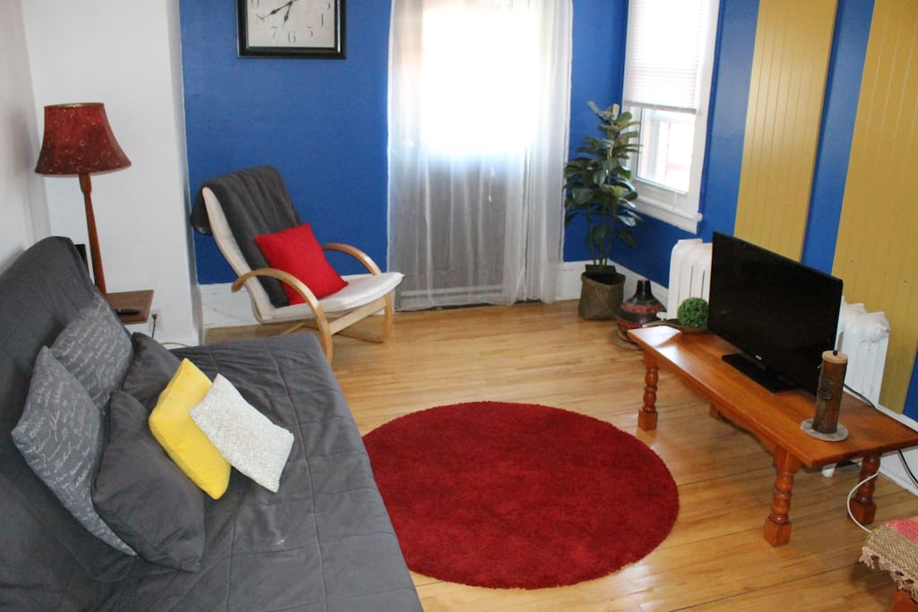 Living Room with Futon Sofa bed and Cable TV