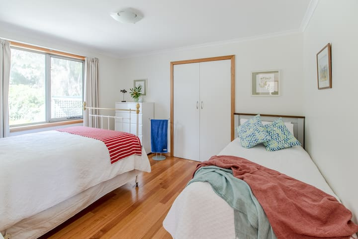 The third bedroom has a single and double bed with in-built cupboards.
