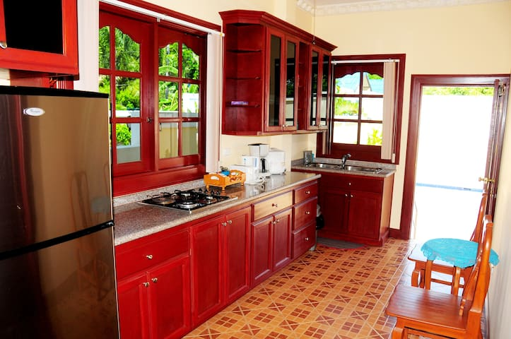 Kitchen also has kettle, coffee machine, rice cooker, microwave and mini stove oven and toaster.
