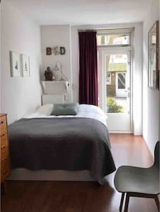 Cozy & clean bedroom with bicycles to rent.