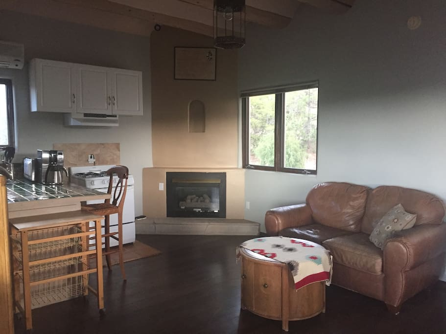 Spacious living area with gas fireplace and leather couch.