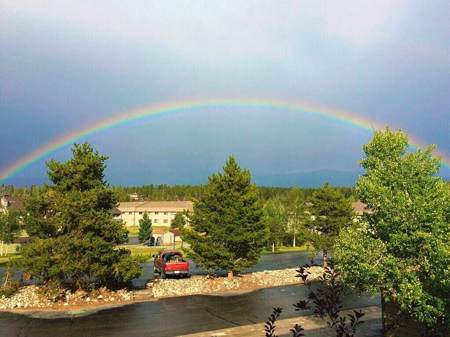 Incredible view of the Indian Peaks behind this rainbow from the 2nd story condo deck. The free Winter Park/Fraser ski lift bus pickup is just steps away, out front along the picnic area.