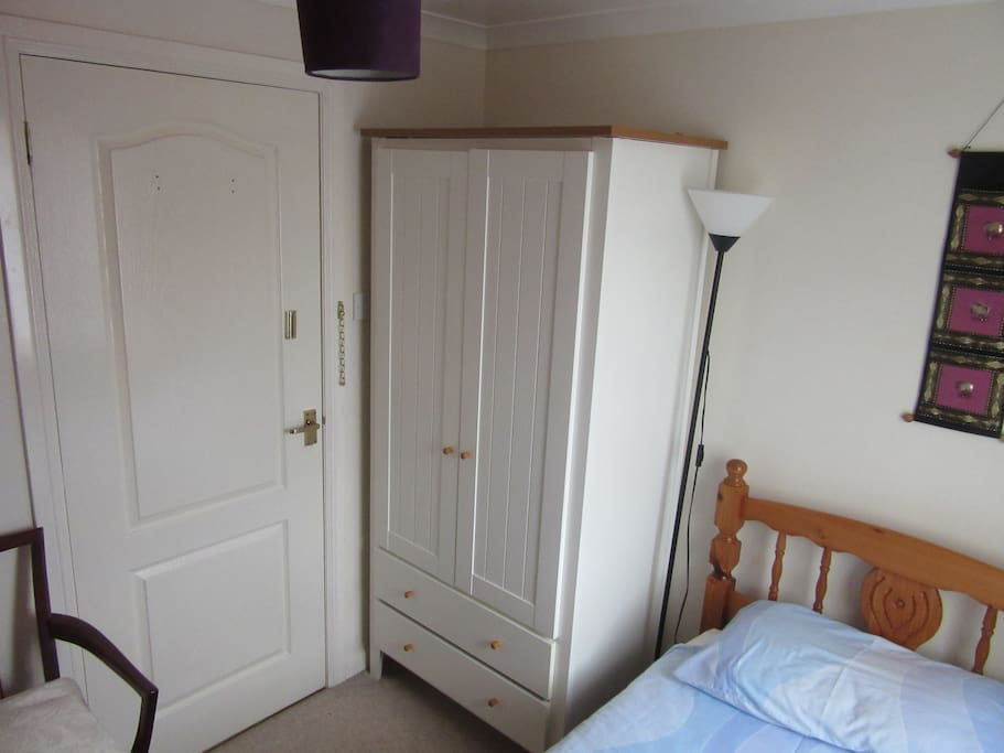 compact single bedroom with wardrobe, single bed, small drawer unit, free fast speed wifi, two lamps, hospitality tray, TV/DVD