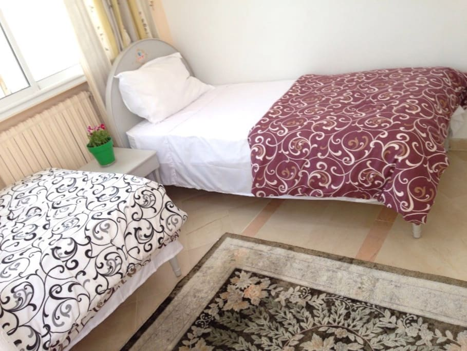 2 cozy single beds with bathroom nearby - View on large play area