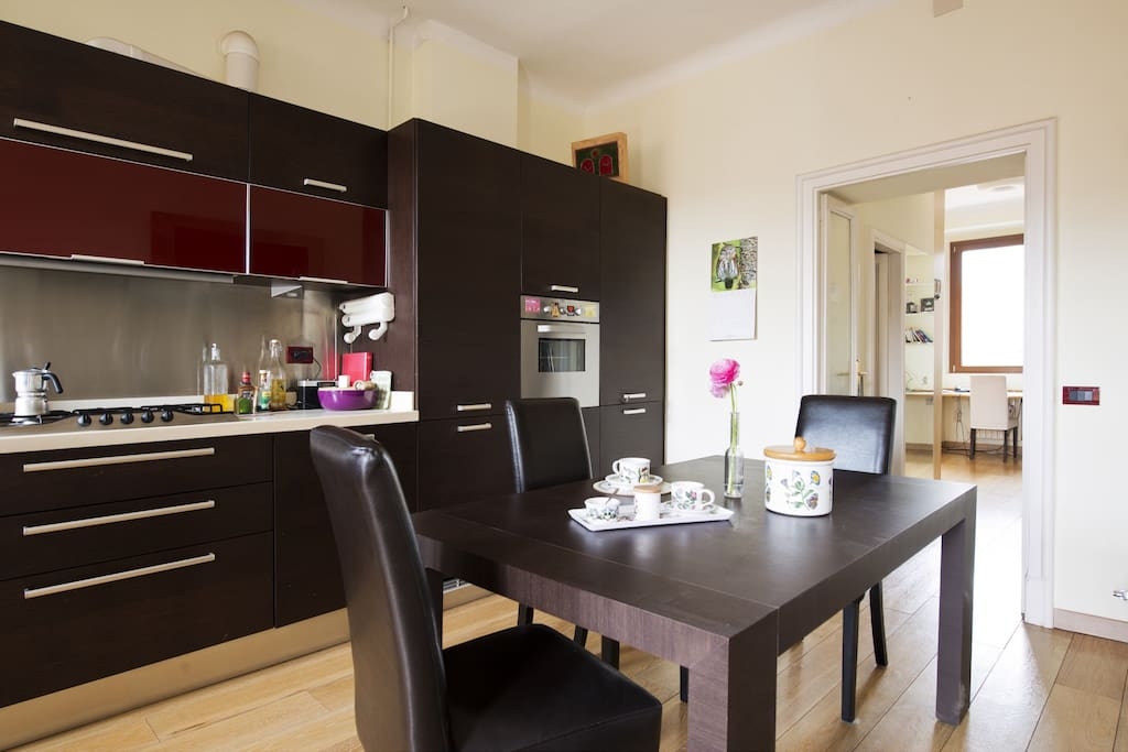 Fully equipped dining kitchen. Custom made furniture. Corian top. Faces a balcony.