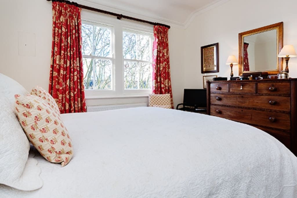 Large double bedroom with own TV