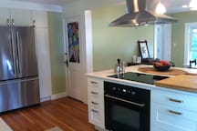 The kitchen is the gathering space.  The island is extra large for gathering around.