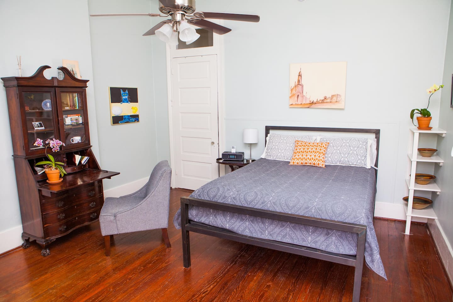 The main room has a queen size bed, a desk and a radio with a loaded ipod.