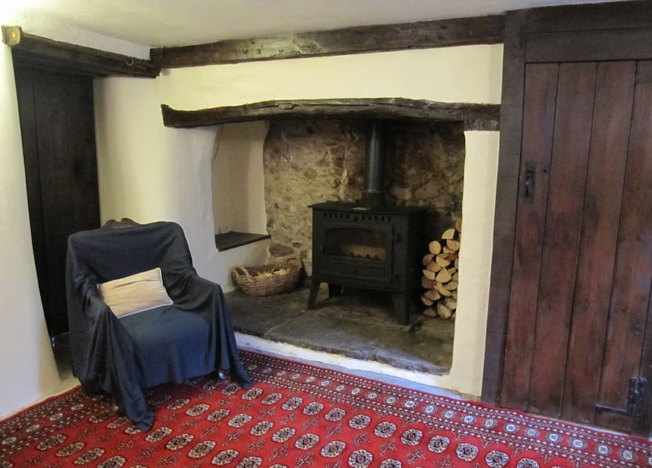 Inglenook with woodburning stove.