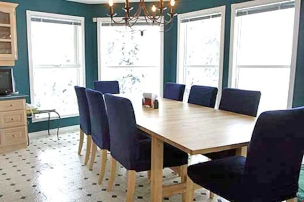 Enjoy meals together or entertain guests at the dining table, with seating for everyone.