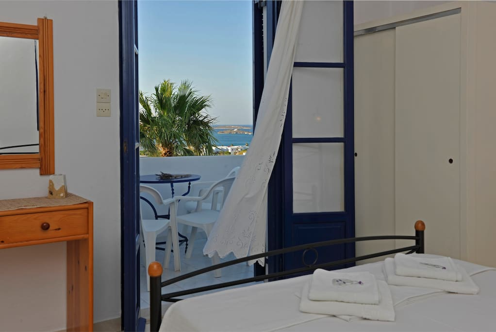 Bedroom and private balcony with sea view