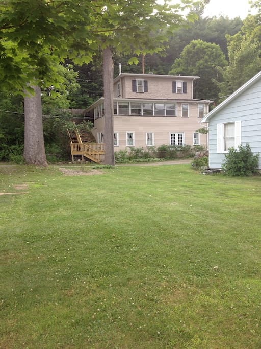 lakeside, looking back at house. Open lawn, 75 feet to water. Great open areas for kids and off street parking.