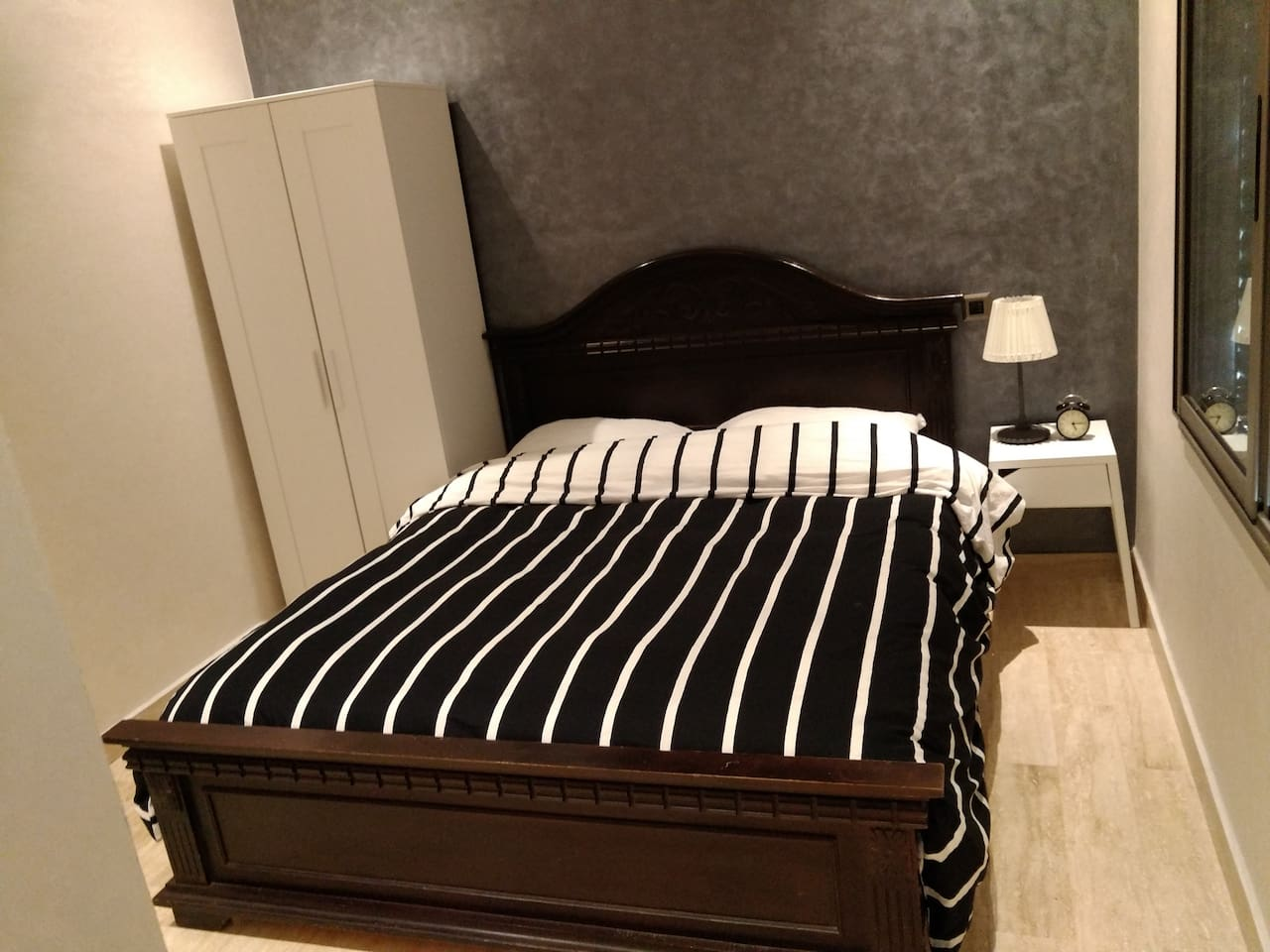 Queen bed in bed room , clothes chest