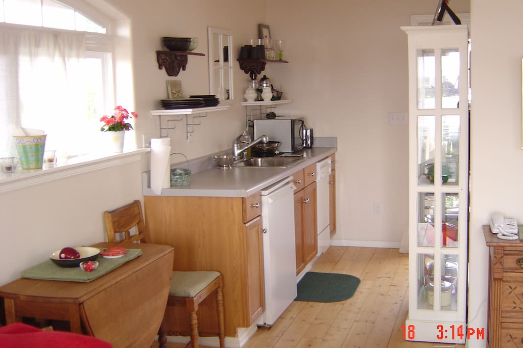 Fully functioning kitchen with dishwaster, Denby pottery and lovely antiques to warm new construction. Claw foot soaking tub and shower.