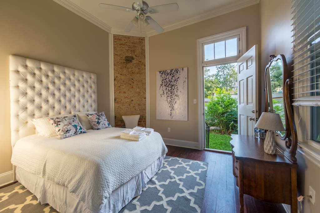 Master queen bedroom has backyard access perfect for pets