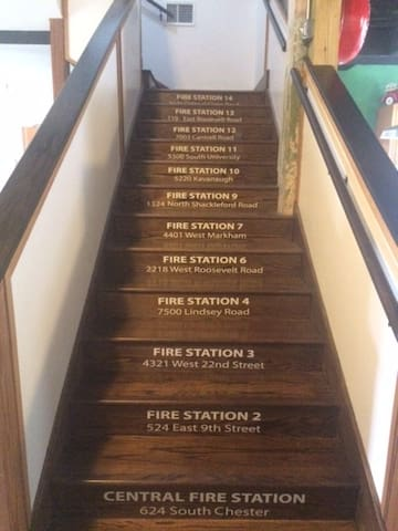 The stairs leading up to the dorms. They list each Fire Station in Little Rock!