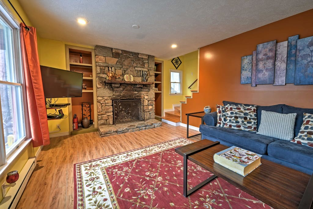 Warm up next to the stone wood-burning fireplace in one of the 2 cozy living rooms.