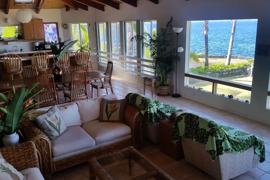 Living room, dining room, & kitchen with ocean views