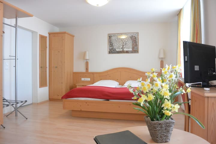 A Quadruple room with Breakfast in our B&B near Salzburg main station and Old Town