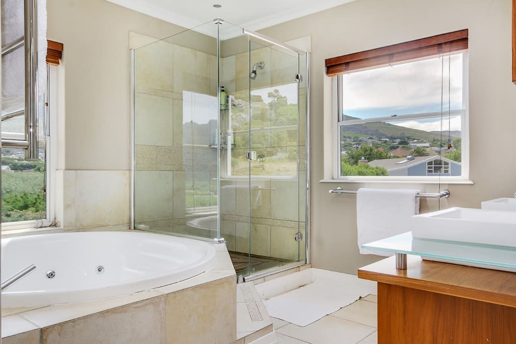 main en suite with bath and shower