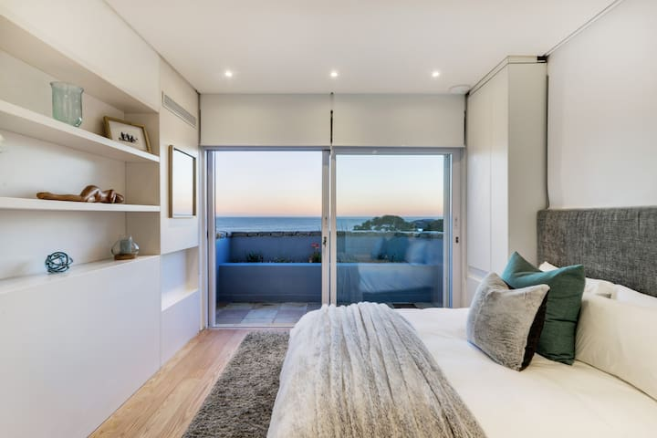 Second bedroom, also boasts ocean views and an ensuite bathroom.
