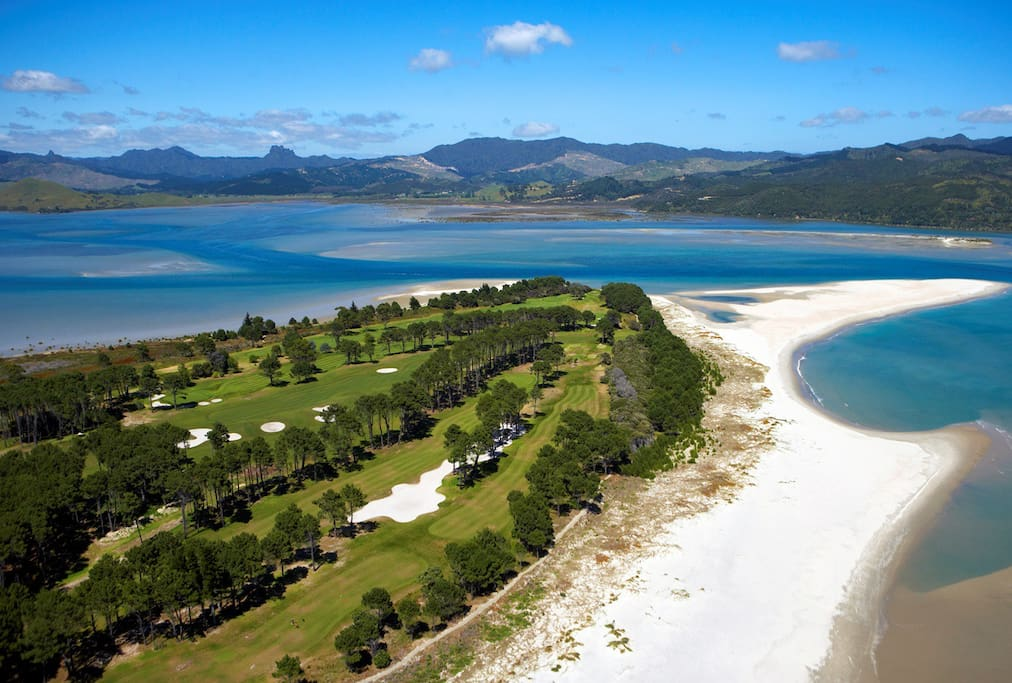 The Matarangi spit. The end of the peninsula with white sandy beach and the golf course.
