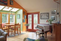Dining area, access to the deck and a piano to enjoy