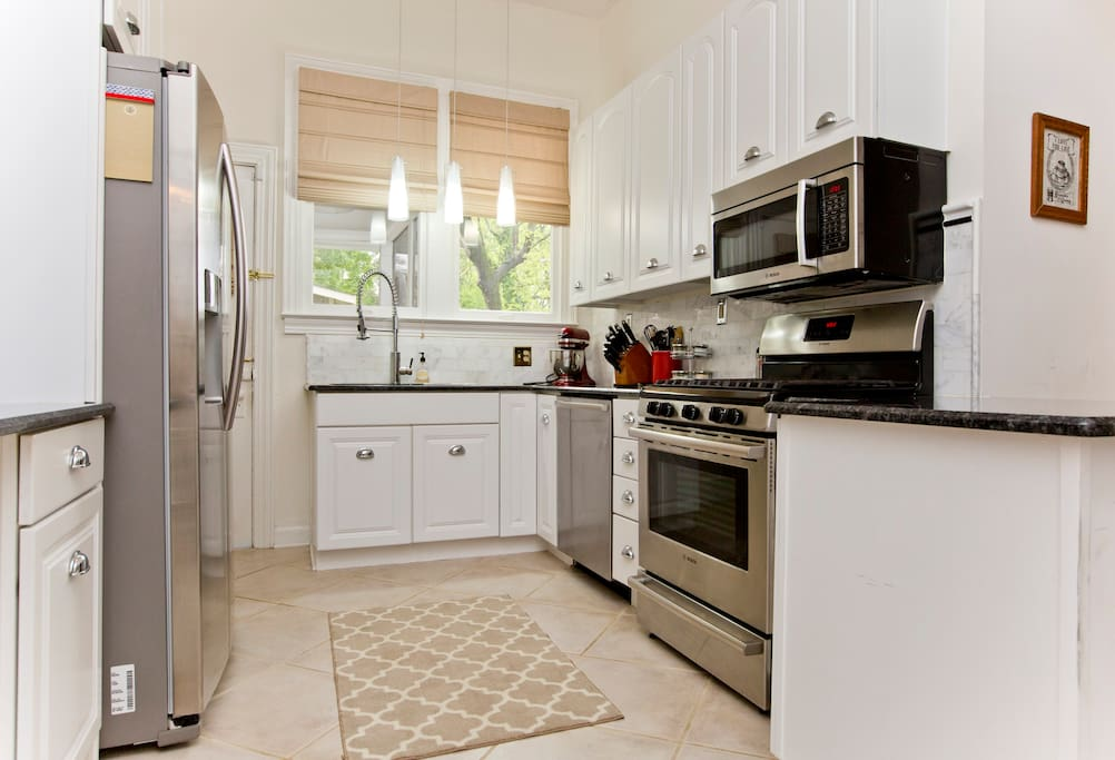 Sunny kitchen complete with Bosch appliances, coffee maker and espresso machine