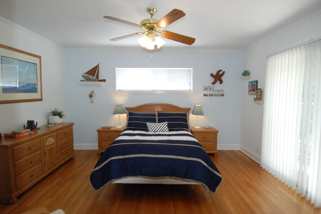 Sunny bedroom with access to back yard through sliding door