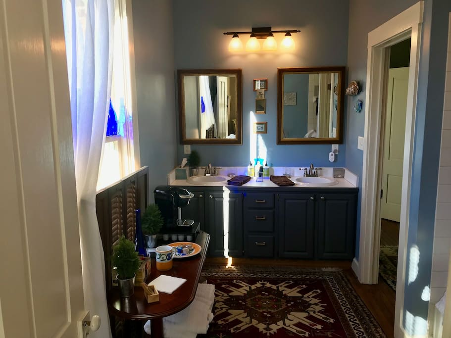 Large, double-sink, private en-suite bath with tub and shower. Hair dryer, towels, soaps, shampoos, and even a Keurig coffee-maker (with different k-cup options, of course) are included.