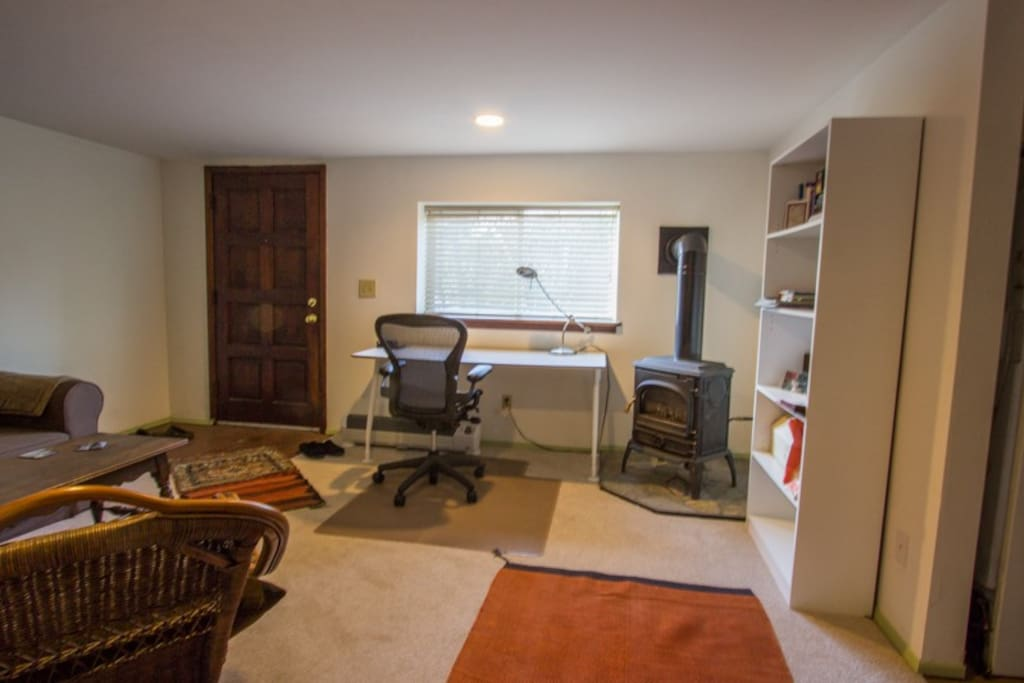 Cheery home office with gas stove and pull out bed.