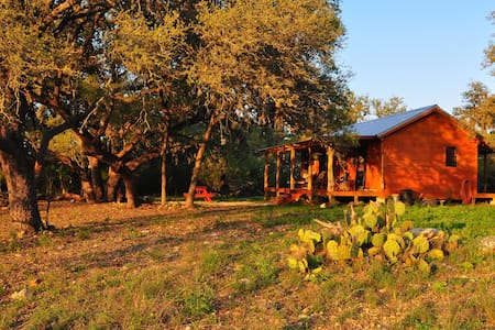 Secluded, fully furnished cabin on 200 private acres in beautiful Utopia, TX. Remote, quiet & peaceful. Enjoy wildlife viewing and nature. Near Lost Maples & Garner State Parks. This working ranch is the home of UTOPiAfest, an annual music festival.