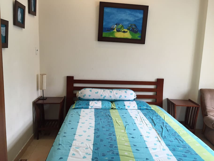 Queen size bed with soft mattress - view from entrance